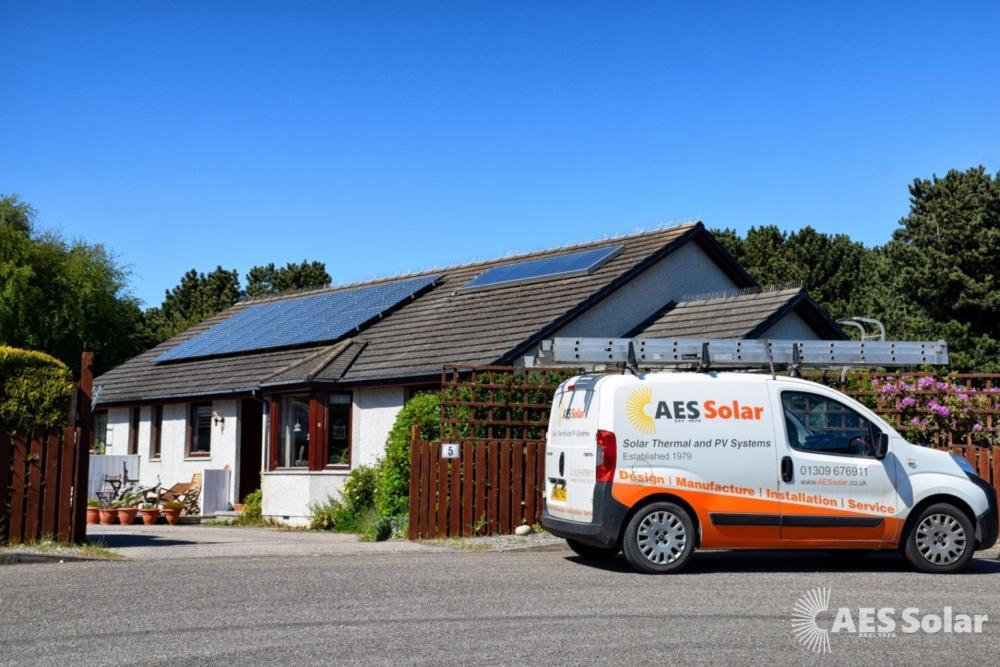 A photo of the AES Solar van outside a house in Findhorn with a split pv and solar thermal system.