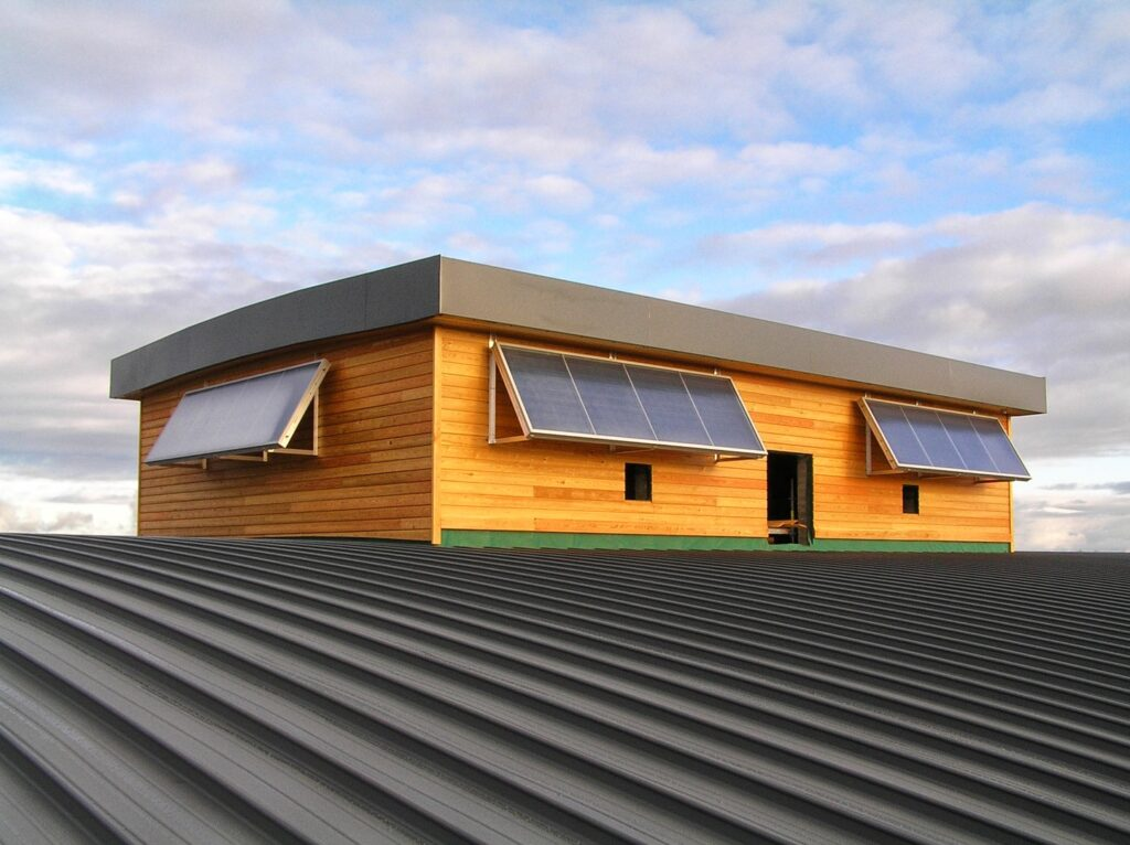 Rectangle shed on large corrugated roof with 12 solar panels