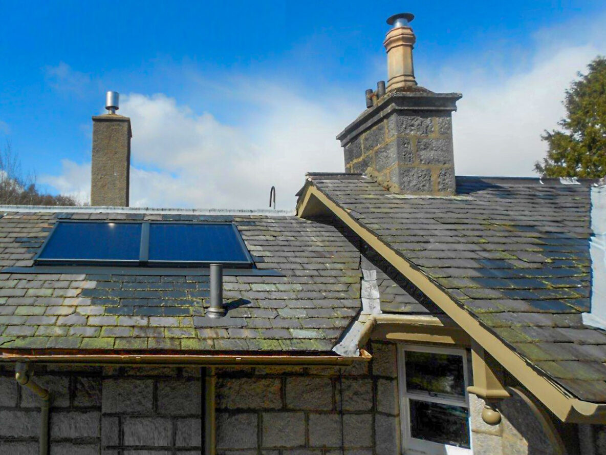 A close up of a building on the Balmoral Estate with solar panels on roof