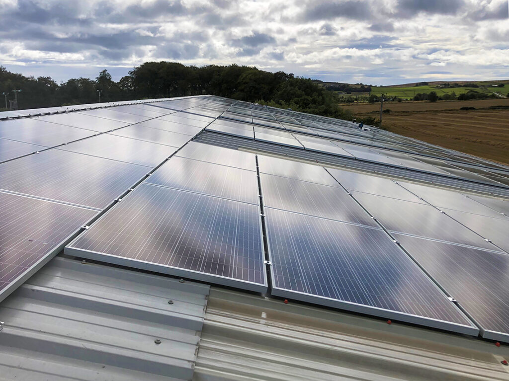 Large commercial roof with solar panels
